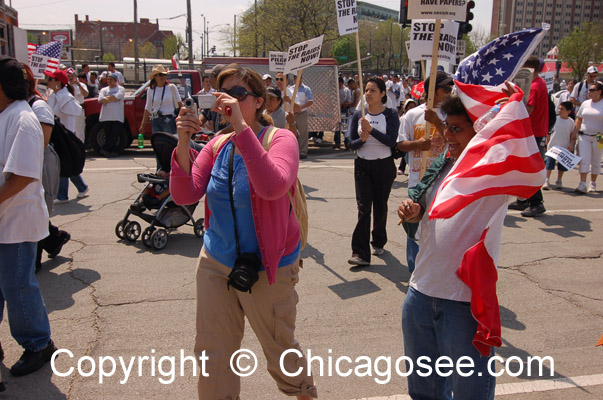 Woman photographer at Immigration March, Chicago, 2007